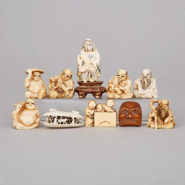 A Group of Ten Ivory and Wood Carved Netsukes