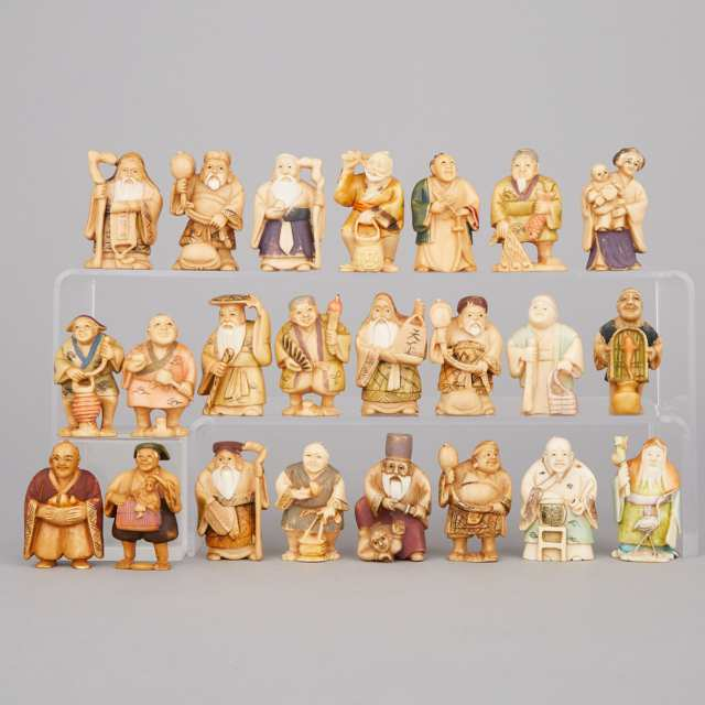 A Group of Twenty-Three Polychrome Ivory Figures