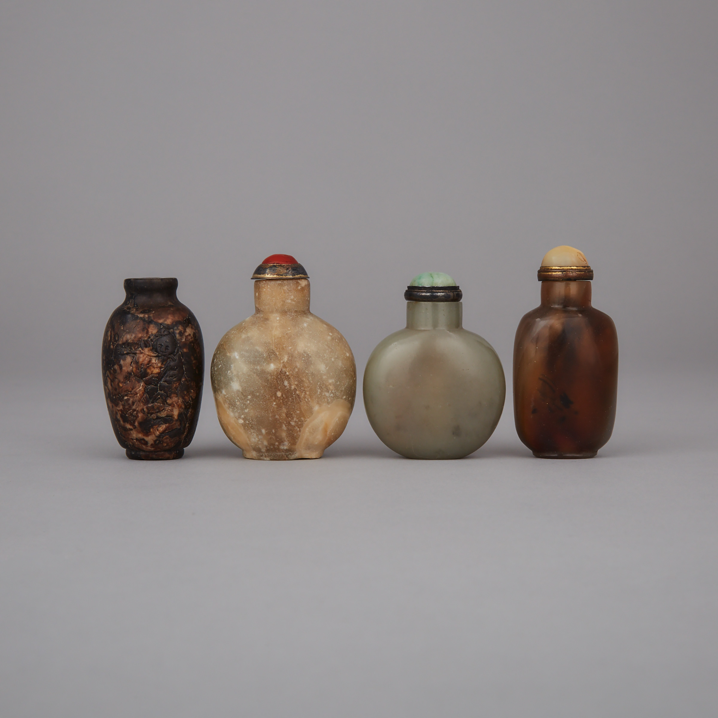 A Group of Four Snuff Bottles, 19th/20th Century