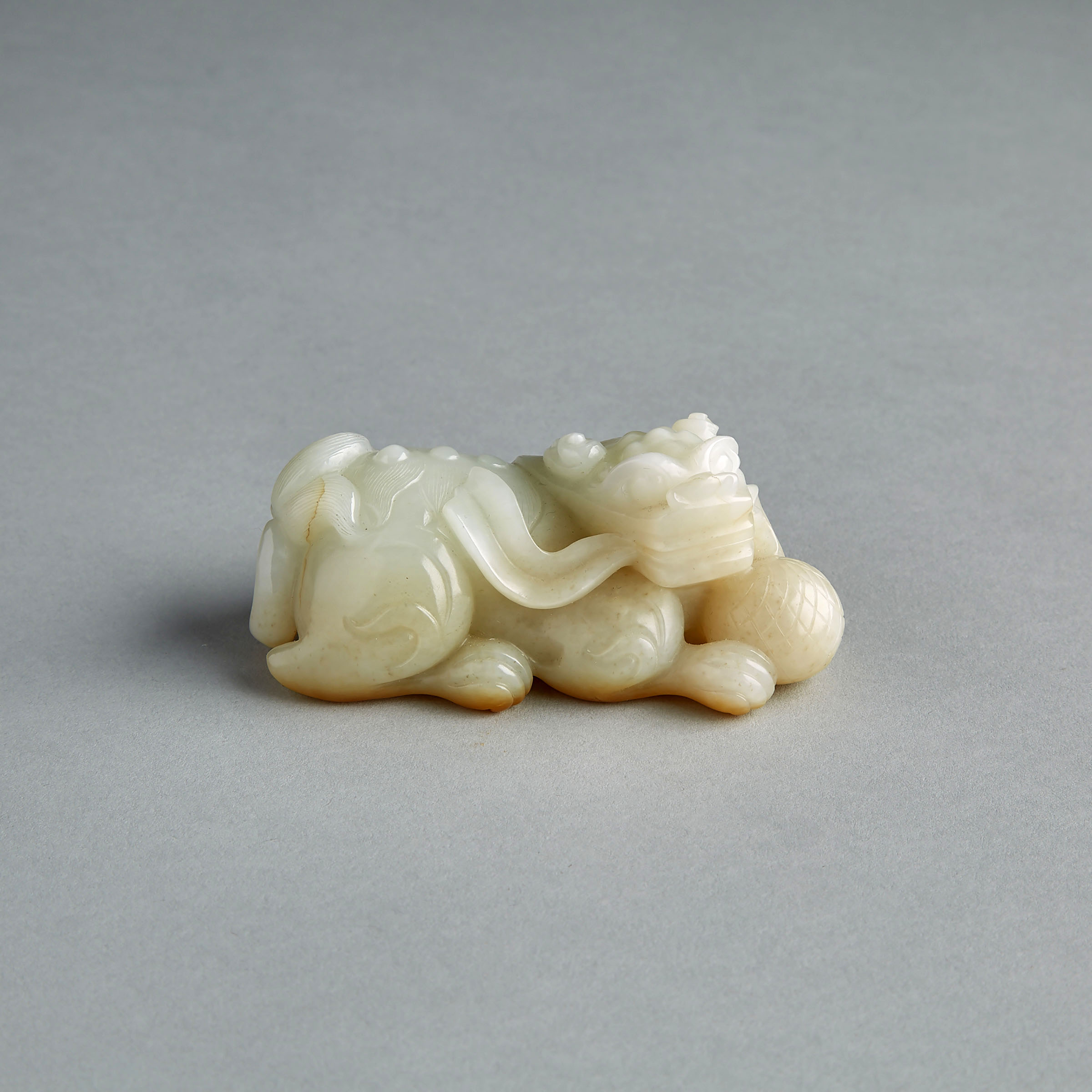 A White and Russet Jade Lion Carving