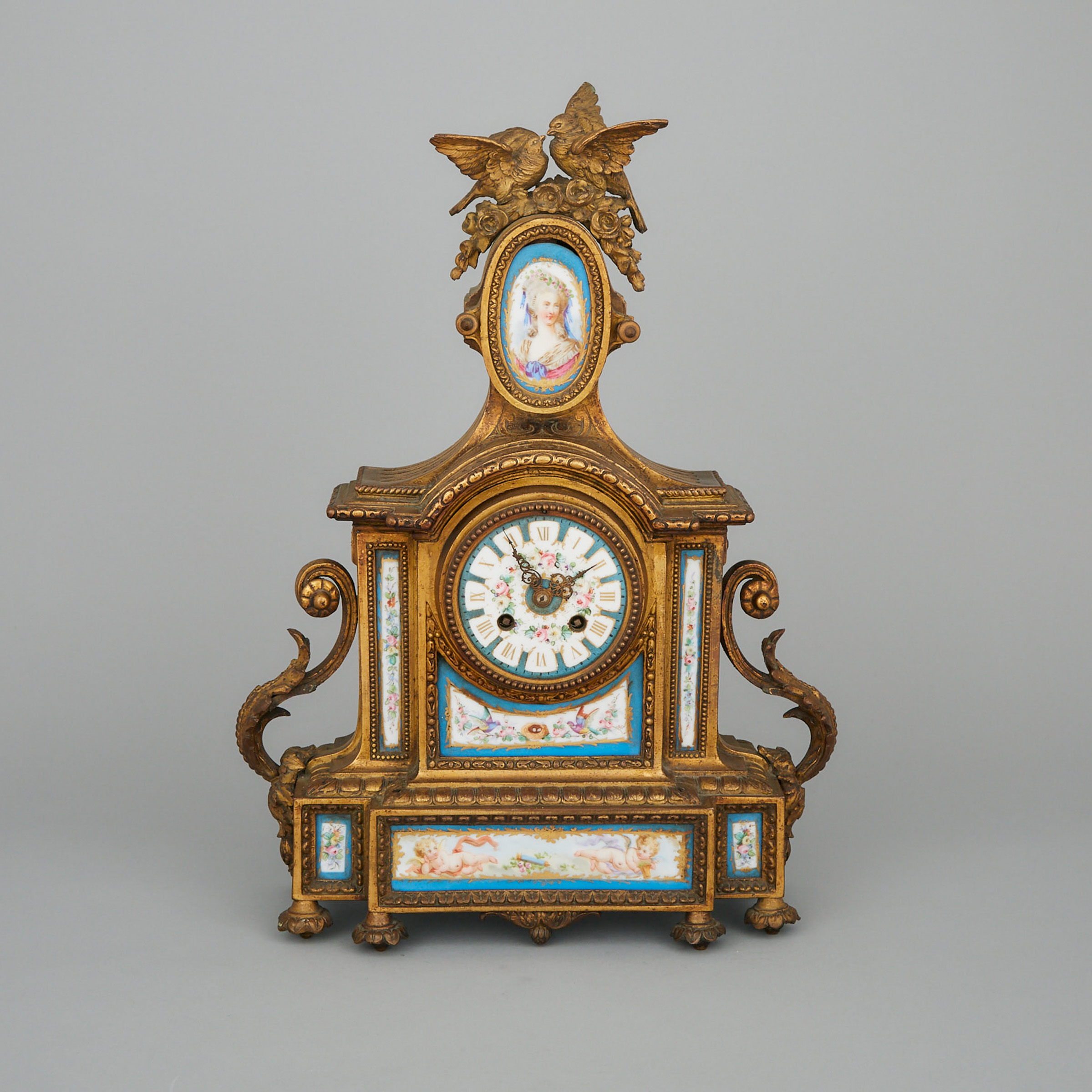 Louis XVI Style Sevres Style Porcelain Mounted Gilt White Metal Mantel Clock, 19th century