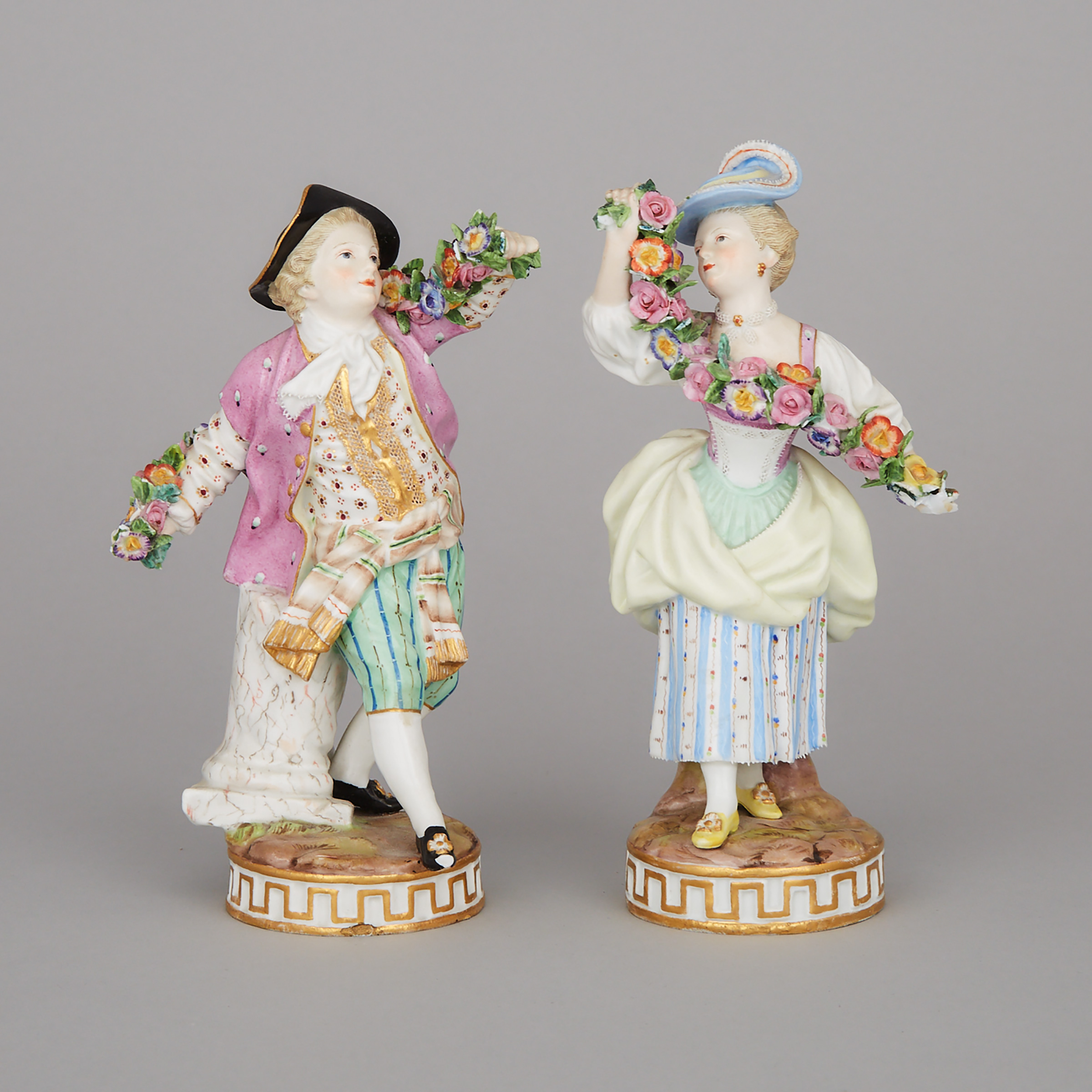 Pair of Meissen Floral Garland Figures, late 19th century