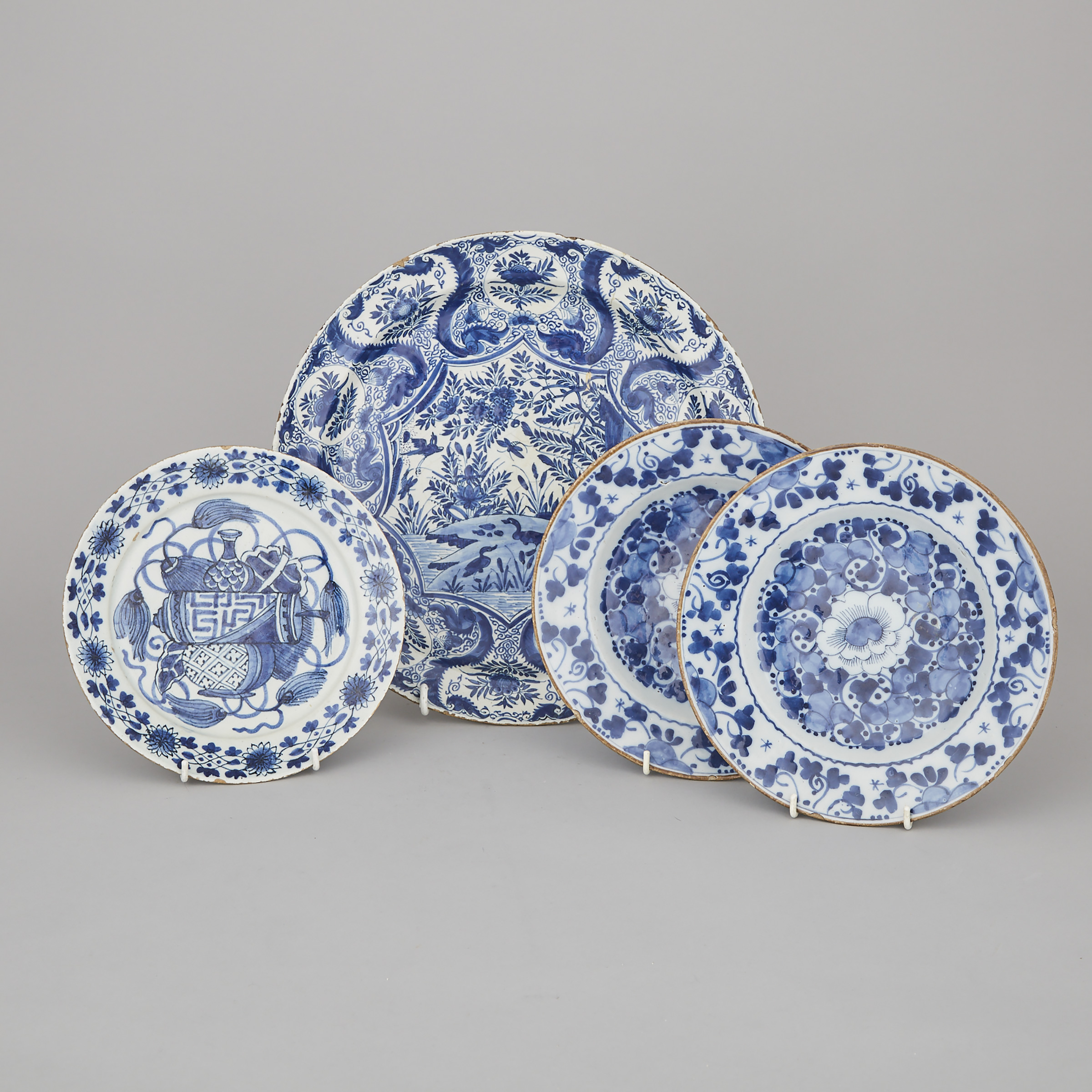 Dutch Delft Blue and White Charger, De Porceleyne Klaeuw, and Three Plates, second half of the 18th century