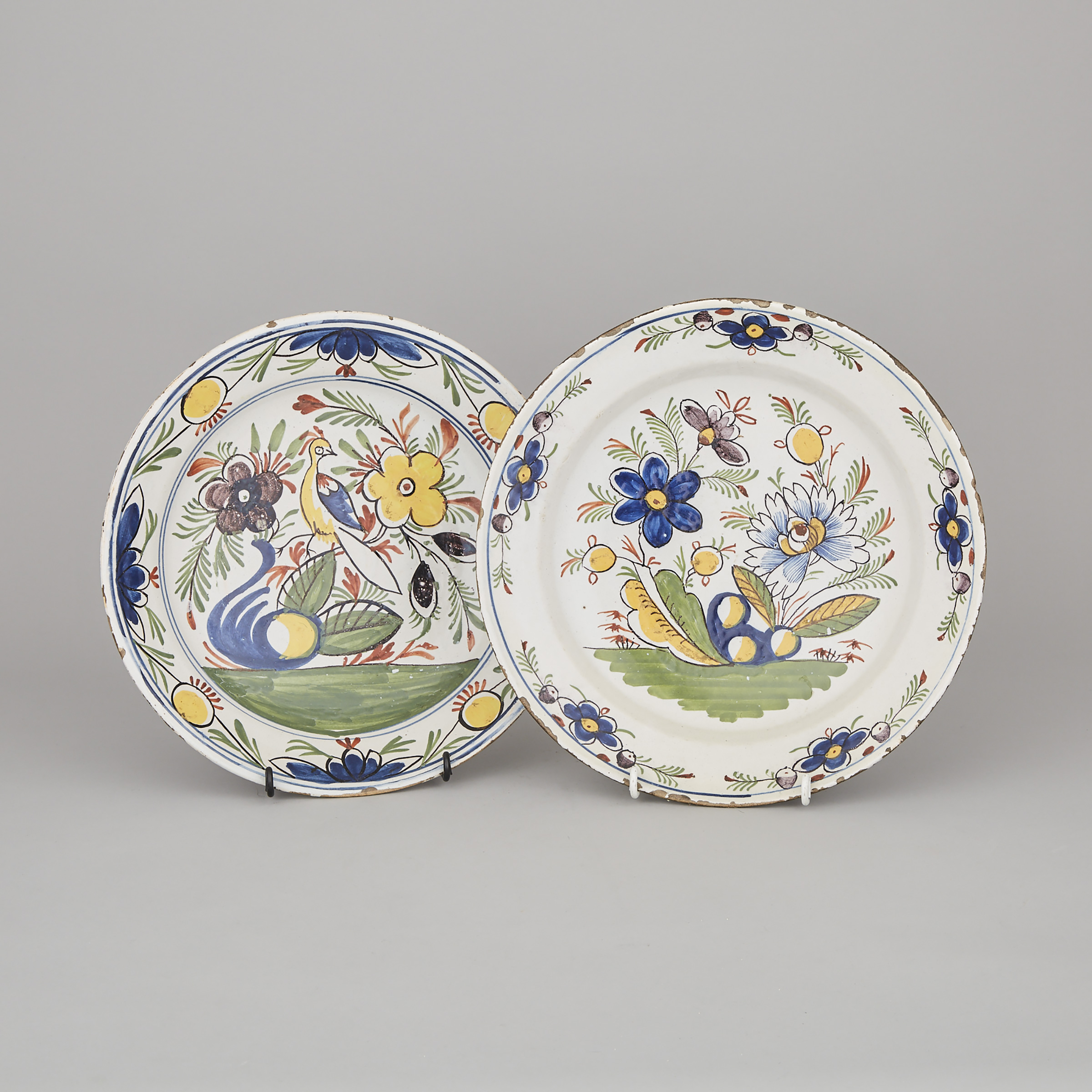 Two Continental Faience Polychrome Chargers, probably Spanish, 18th/19th century