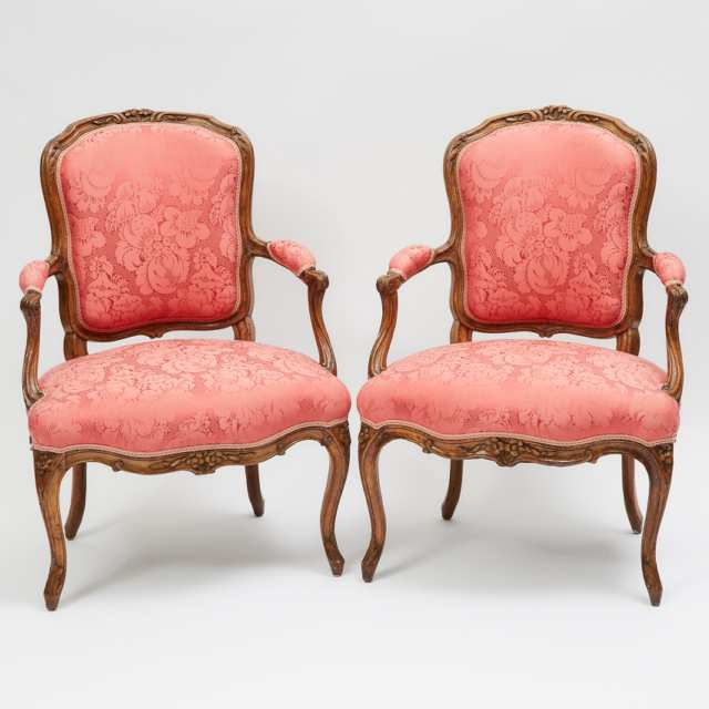 Pair of French Provincial Carved Walnut Fauteuils, 19th/early 20th century