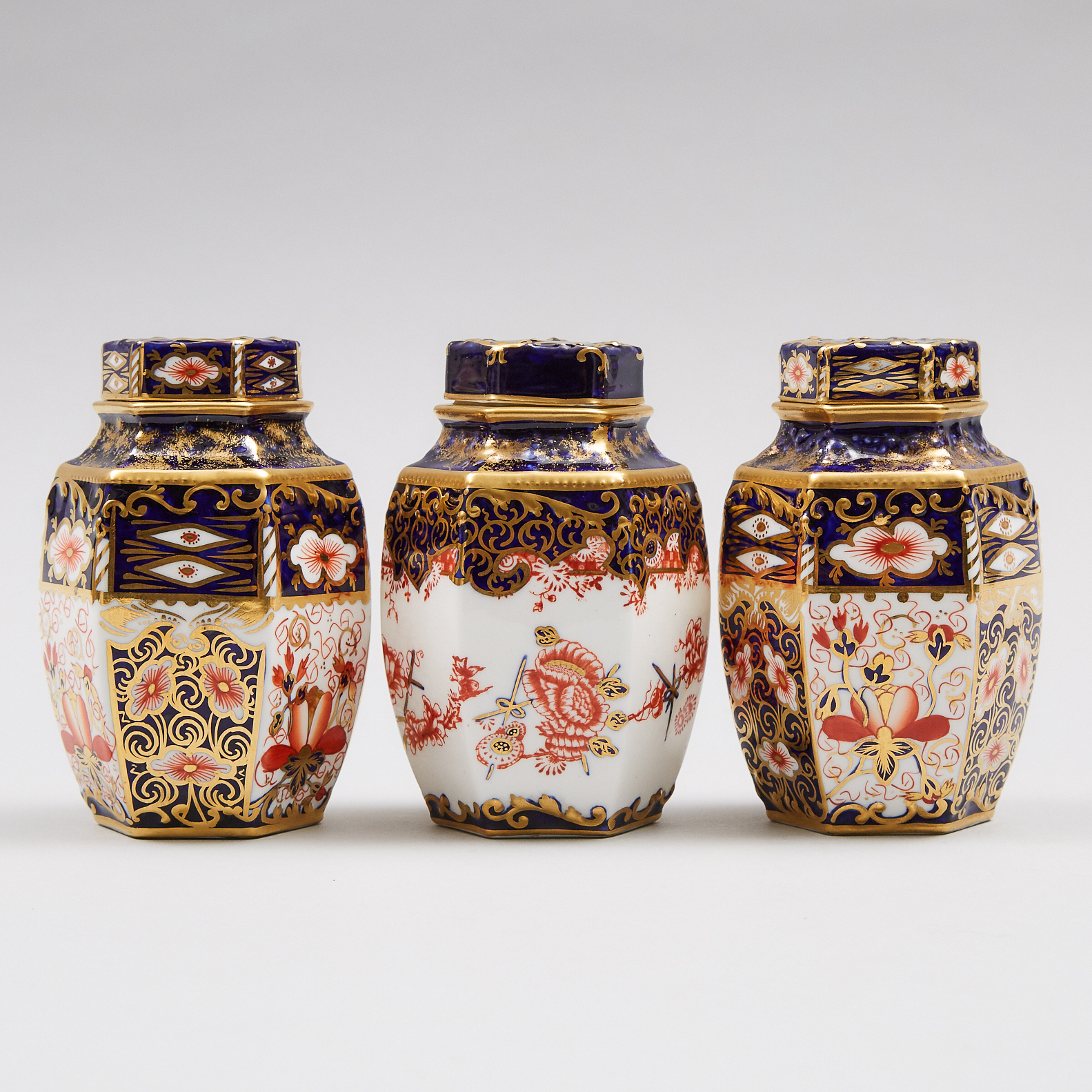 Three Royal Crown Derby 'Imari' (2451) and Japan (2649) Pattern Hexagonal Tea Caddies with Covers, c.1905-16