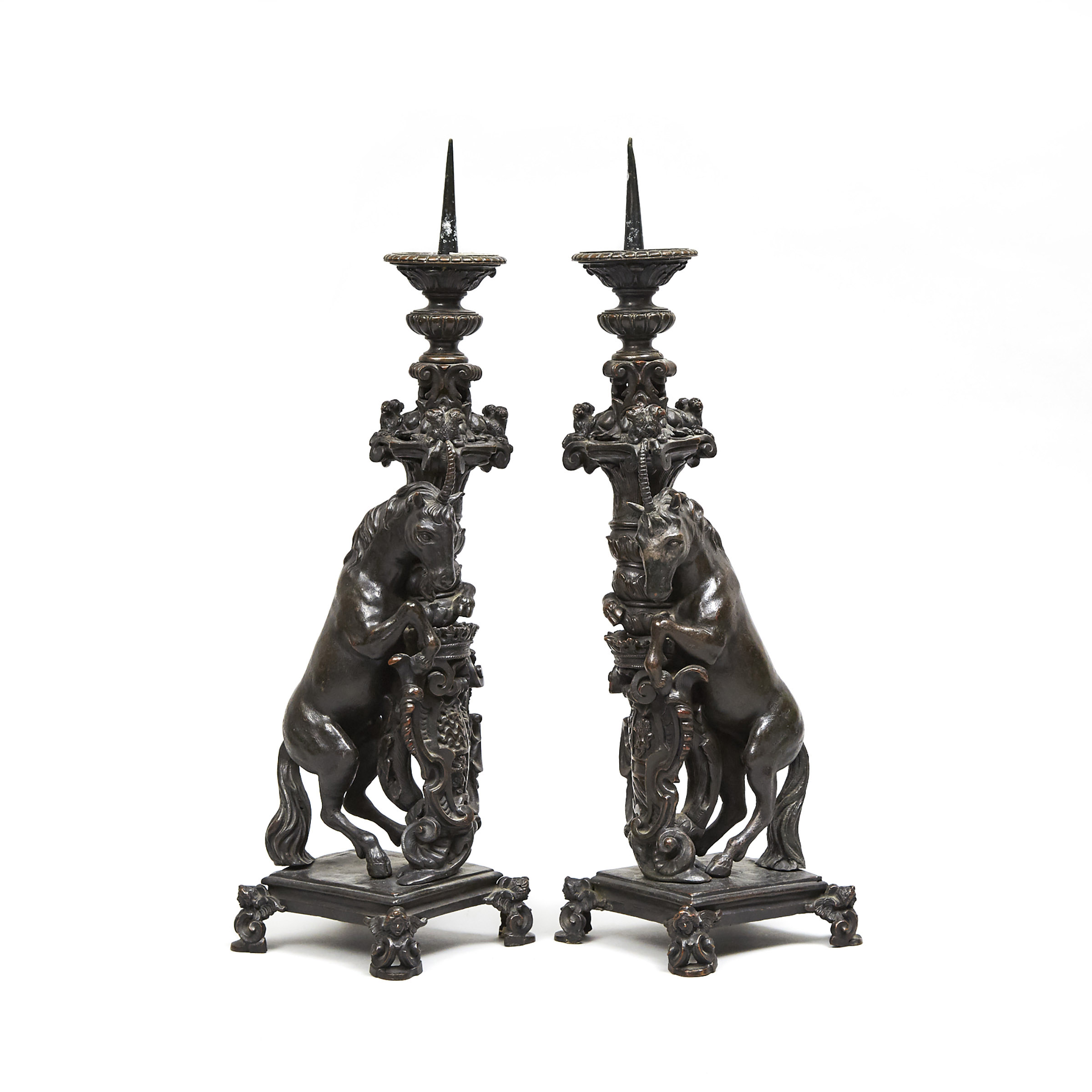 Pair of North Italian Renaissance Bronze Armourial Pricket Candlesticks, 16th or early 17th century
