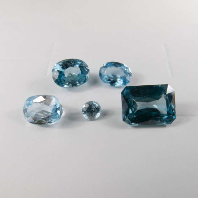 9 Various Cut Blue And Gold Zircons