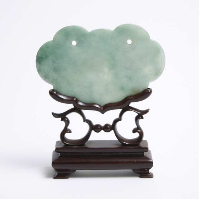 A Jadeite Ruyi Head Lock-Form Plaque with Stand, Qing Dynasty