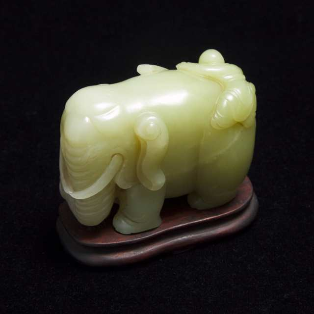 A Celadon Jade 'Elephant and Boy' Carving