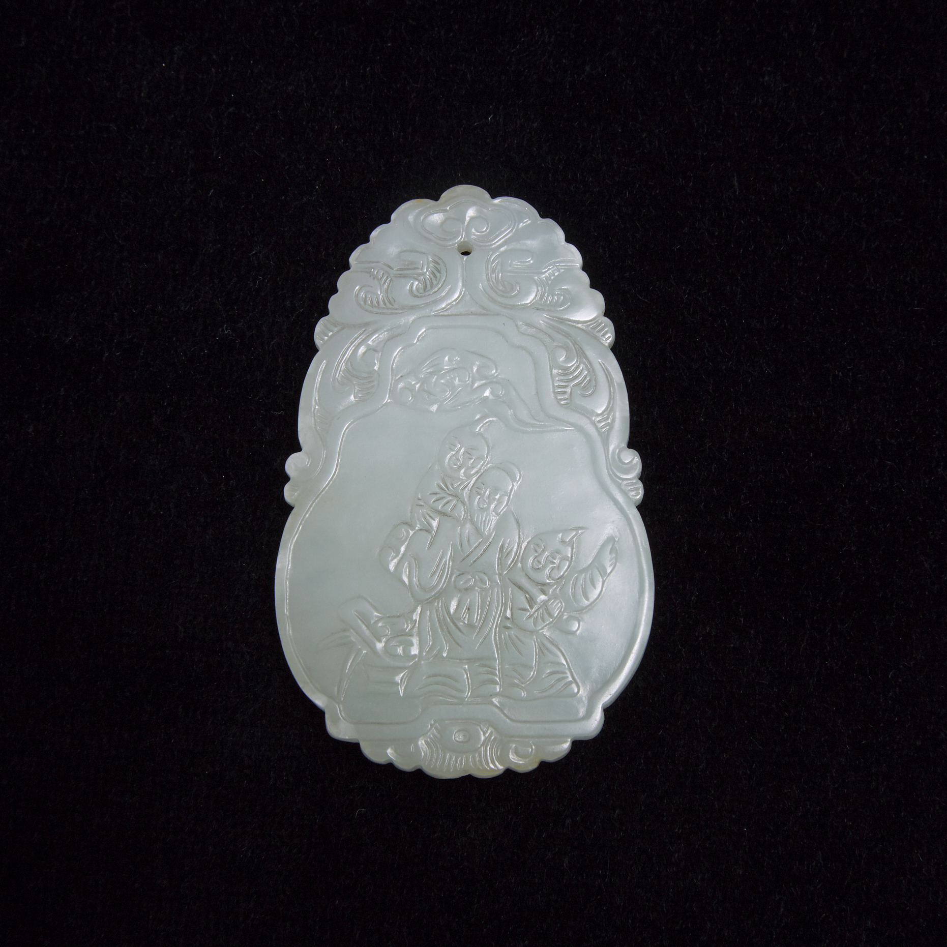 A White Jade Figural Plaque