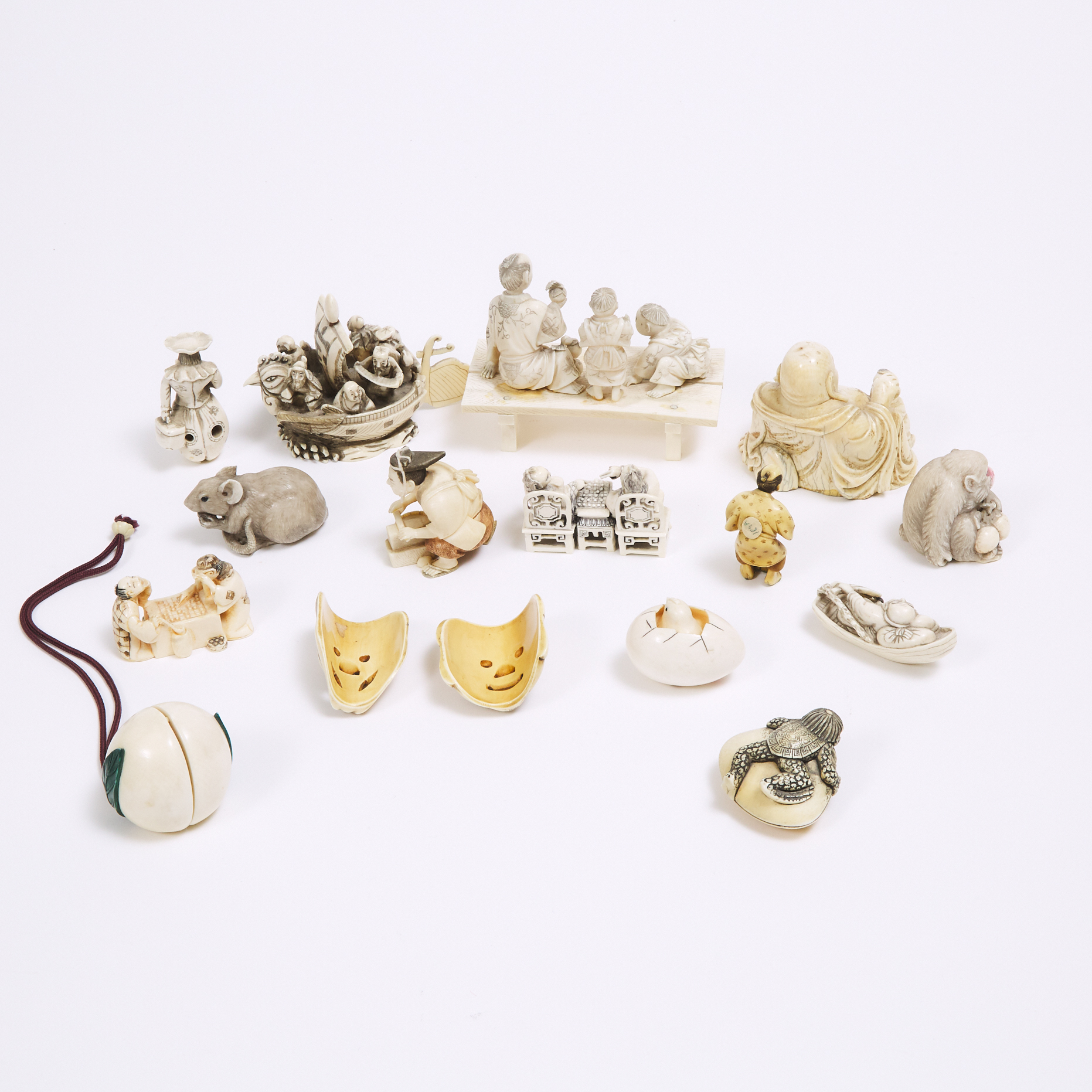 A Group of Sixteen Japanese Ivory and Bone Netsuke and Okimono, 19th/Early 20th Century