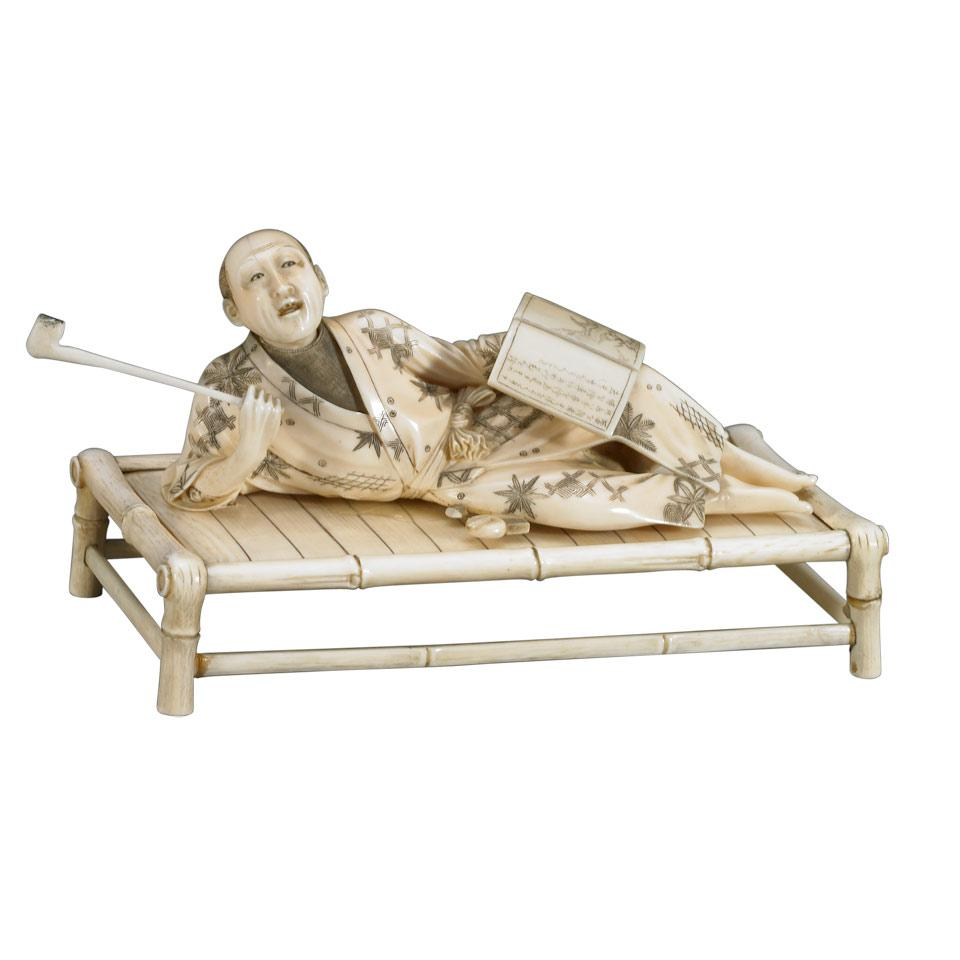 Ivory Okimono of a Man Smoking a Tobacco Pipe, Meiji Period, Circa 1900