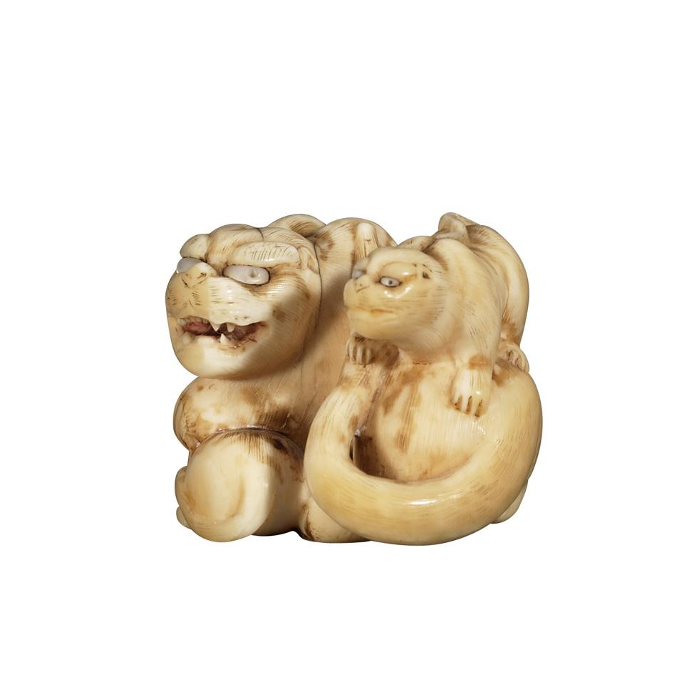 Ivory Netsuke of a Tiger Group, 19th Century