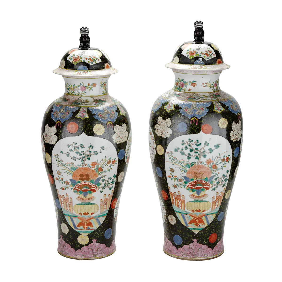 Pair of Famille Rose Black Ground Jars and Covers