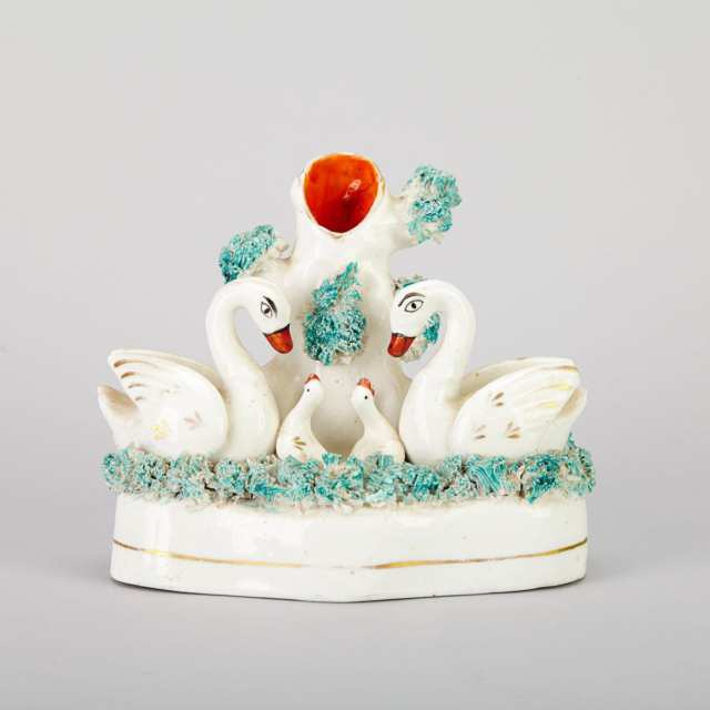 Two Staffordshire Swan Group Spill Vases and a Bower Group of Figures with a Deer, 19th century