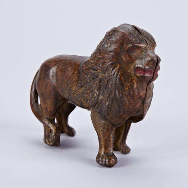 Painted Cast Iron Lion Form Still Penny Bank, 19th century