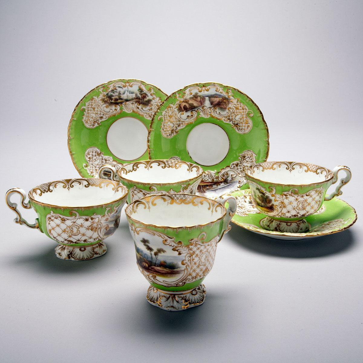Two Copeland & Garrett Apple Green Ground Topographical Cups and Saucers and a Trio, c.1840