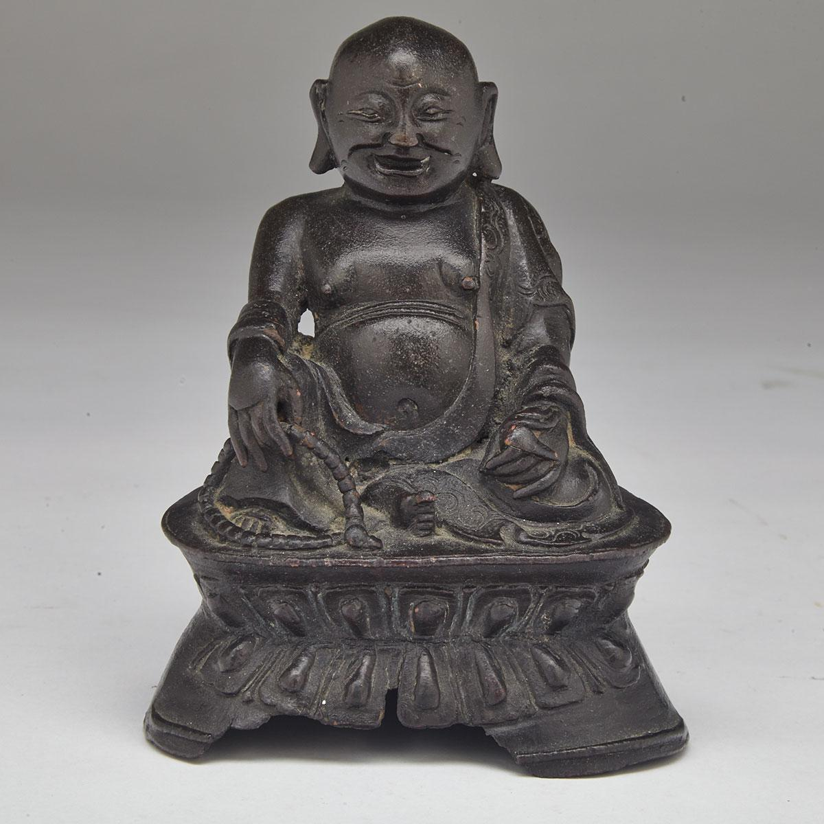 Small Seated Bronze Figure of Putai, 16th/17th Century