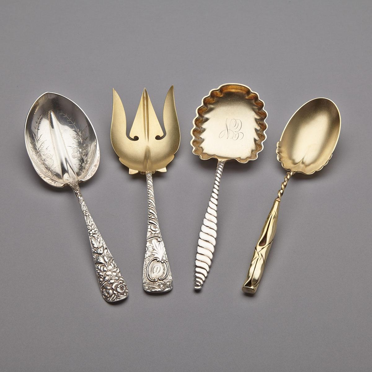 Three American Silver Berry Spoons and a Serving Fork, various makers, c.1900