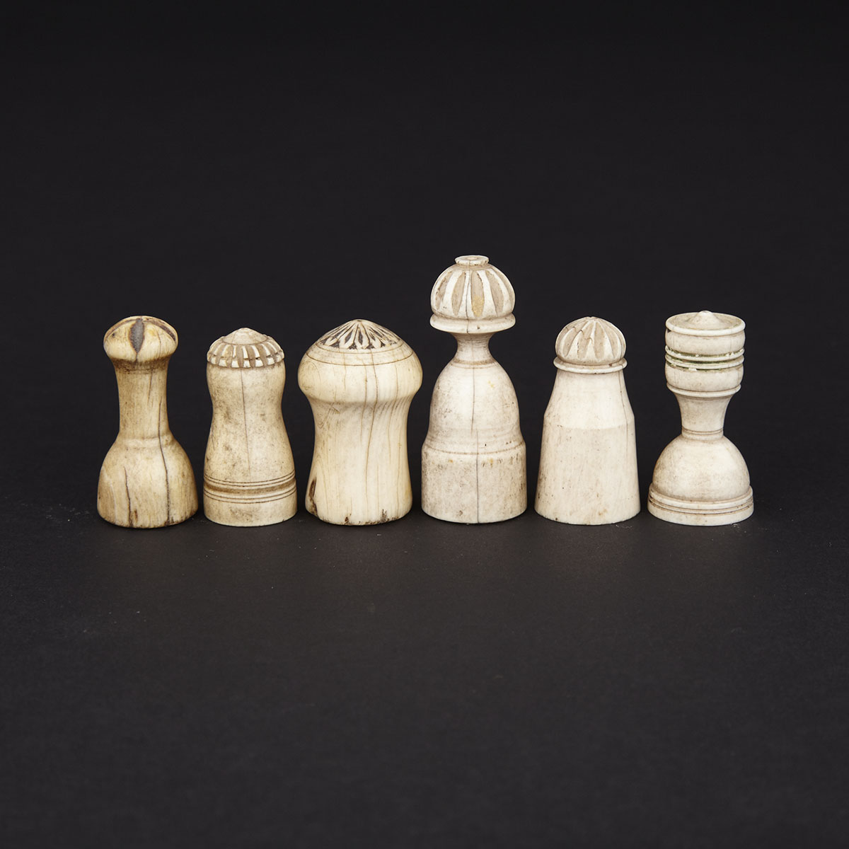 Group of Six Arab Islamic Ivory and Bone Chess Pieces, 18th century and earlier
