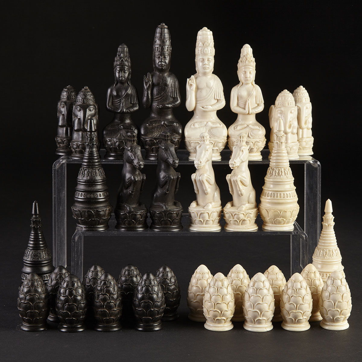 Burmese Buddhist Carved Ebony and Ivory Figural Chess Set, 19th century