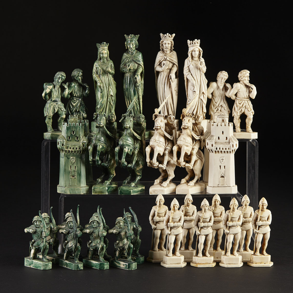 French Carved Ivory 'Battle of Crécy' Figural Chess Set, early 20th century