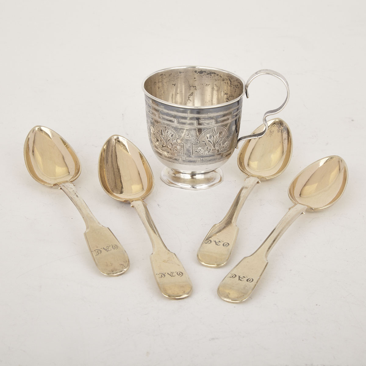 Russian Silver Small Cup, probably Moscow, 1881 and Four Silver-Gilt Fiddle Pattern Tea Spoons, St. Petersburg, 1847