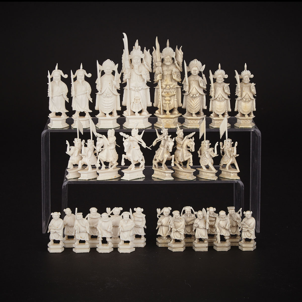 Chinese Carved Ivory 'China vs. Mongolia' Figural Chess Set, Canton, early 20th century