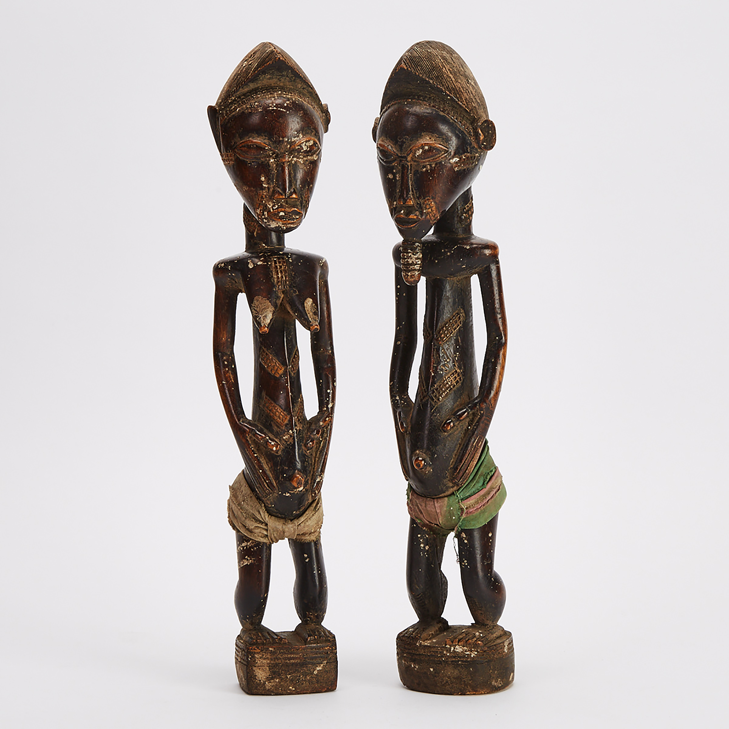 A Pair of Baule Male and Female Ancestral Figures, Ivory Coast, West Africa