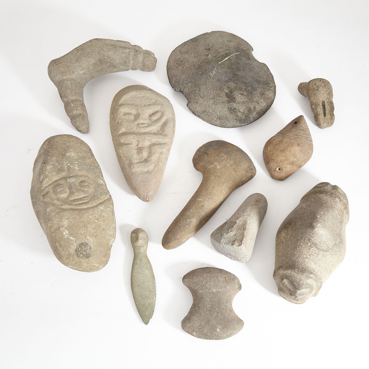 Group of Eleven Stone Sculptures and Tools