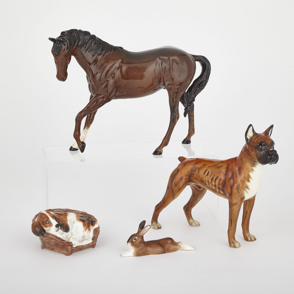 Royal Doulton Horse, Cocker Spaniel in a Basket and a Hare, together with a Goebel Boxer, 20th century