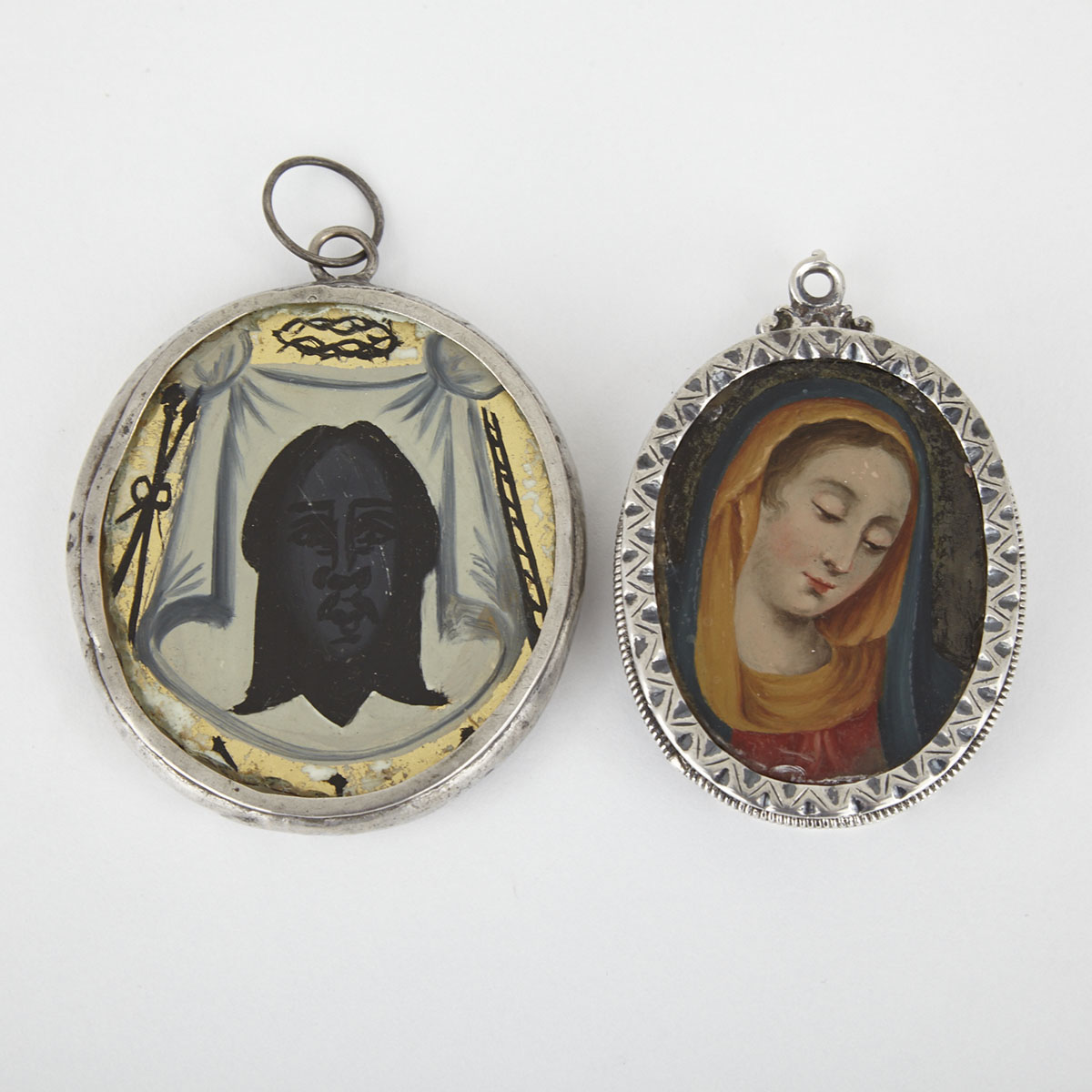 Two Spanish Provincial Silver and Reverse Painting on Glass Double Sided Pendent Icons, c.1860