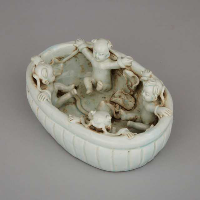 A White-Glazed Moulded Basin with Boys
