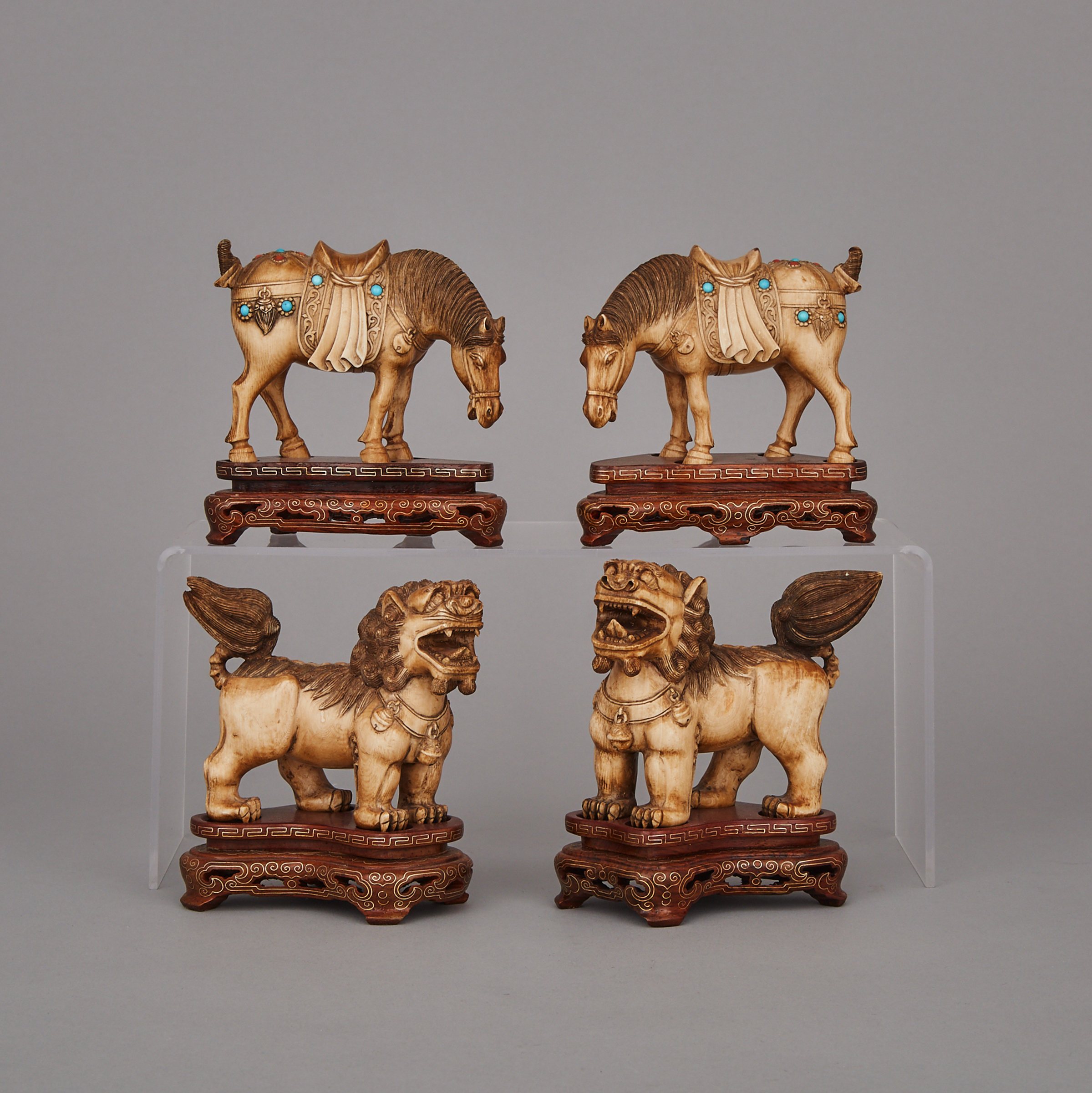 A Group of Four Ivory Carved Beasts