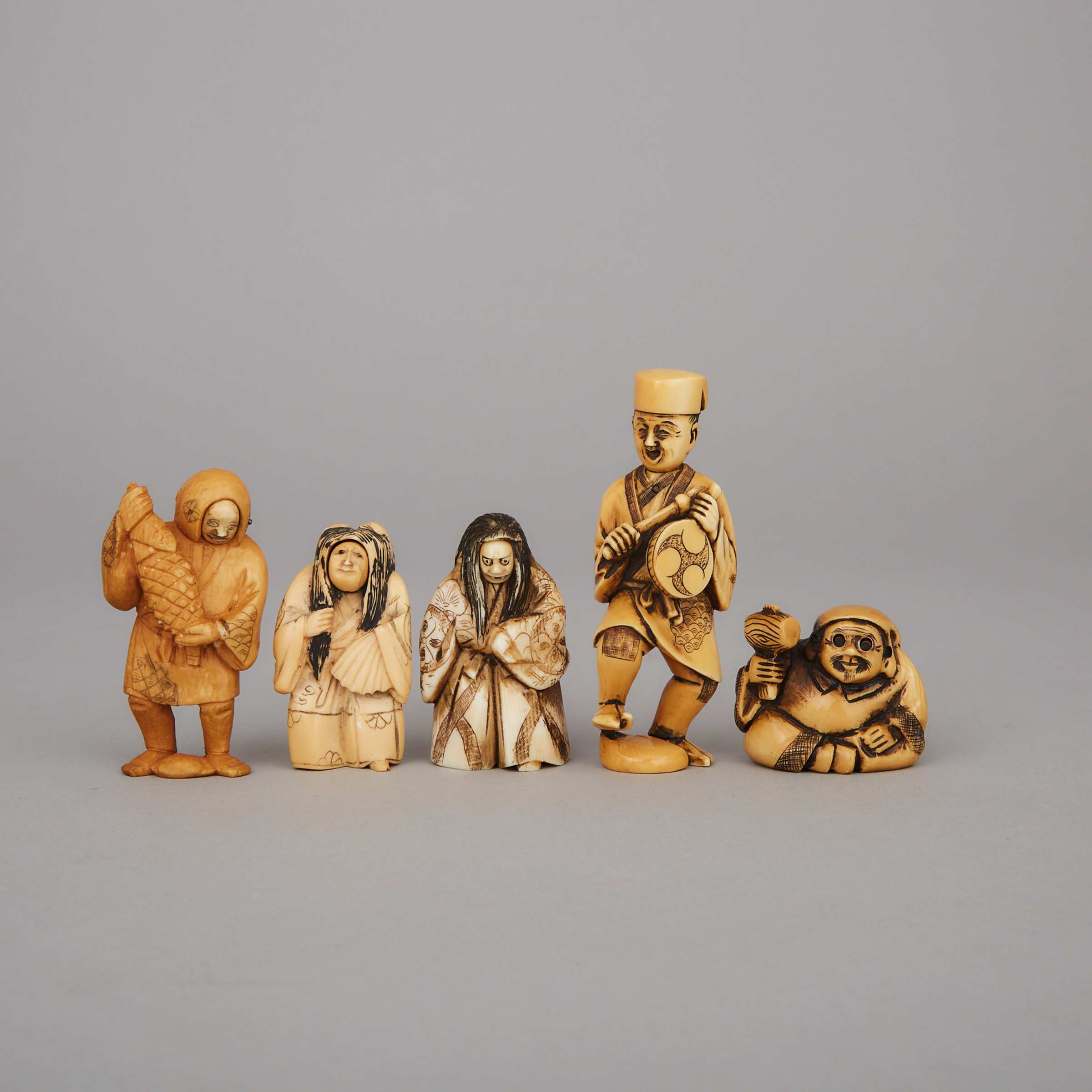A Group of Five Ivory and Ivorine Trick Netsuke, Meiji Period and Later