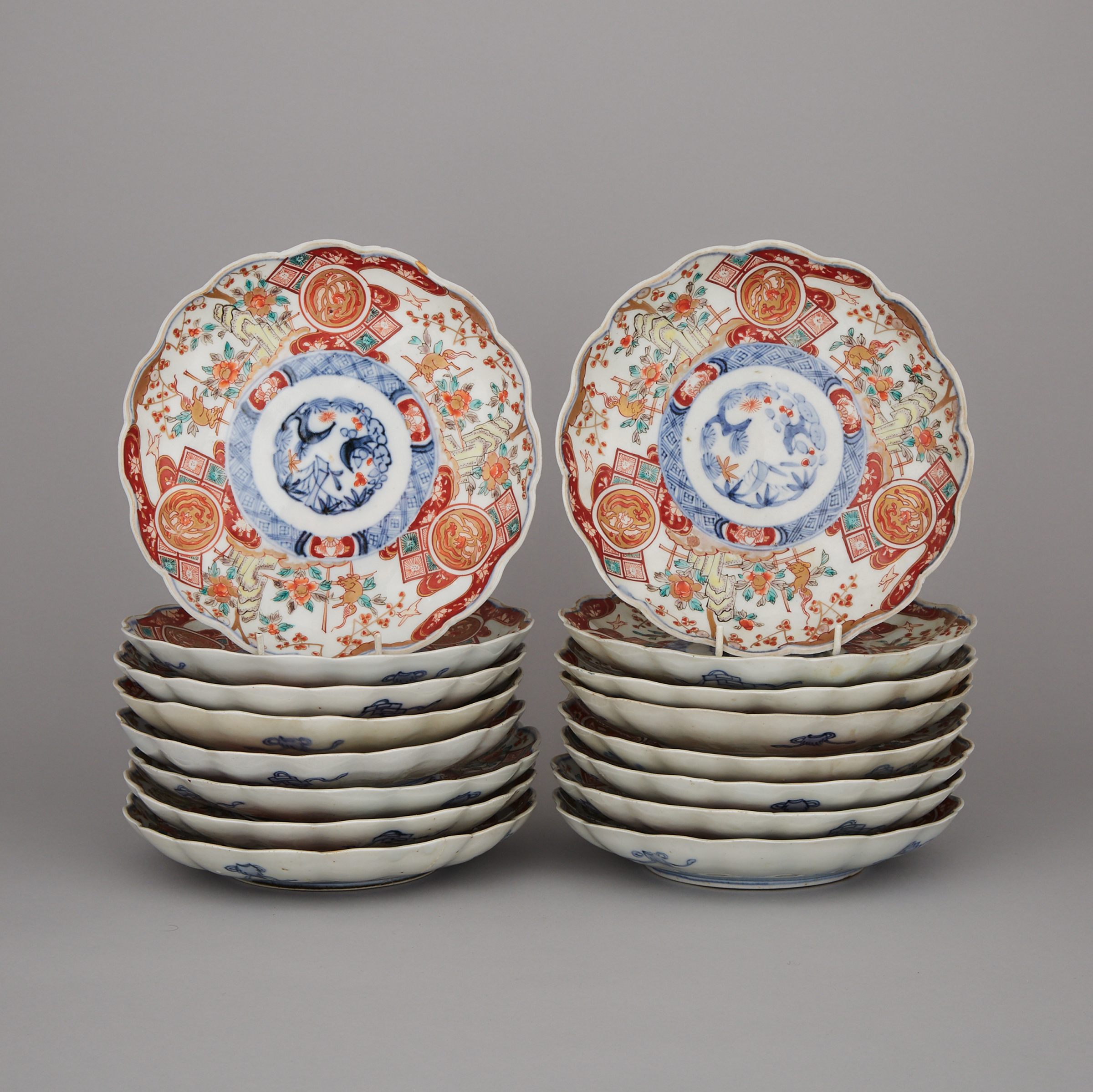 A Set of Sixteen Lobed Imari Dishes, Circa 1900