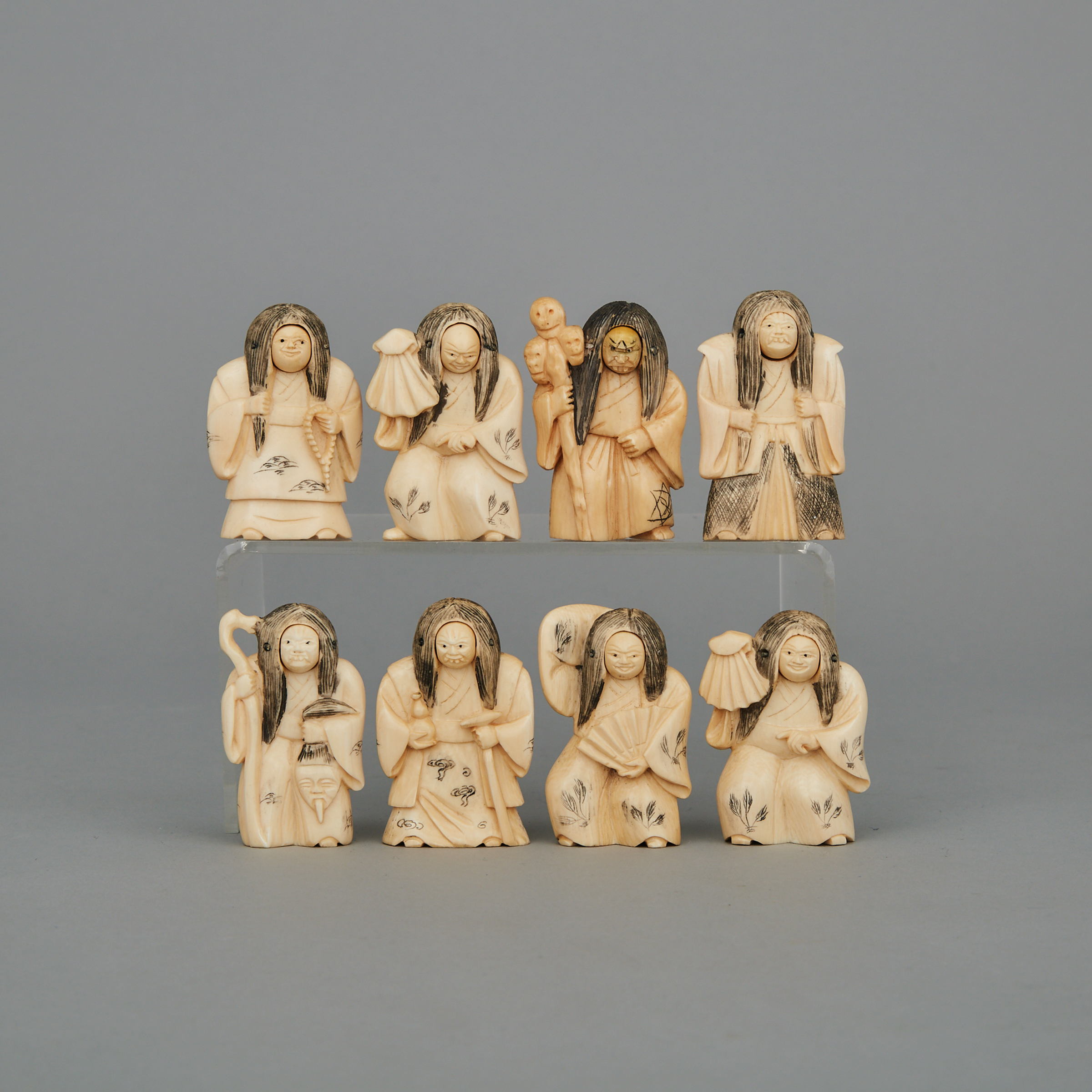 A Group of Eight Ivory Changing Face Figures, Circa 1940