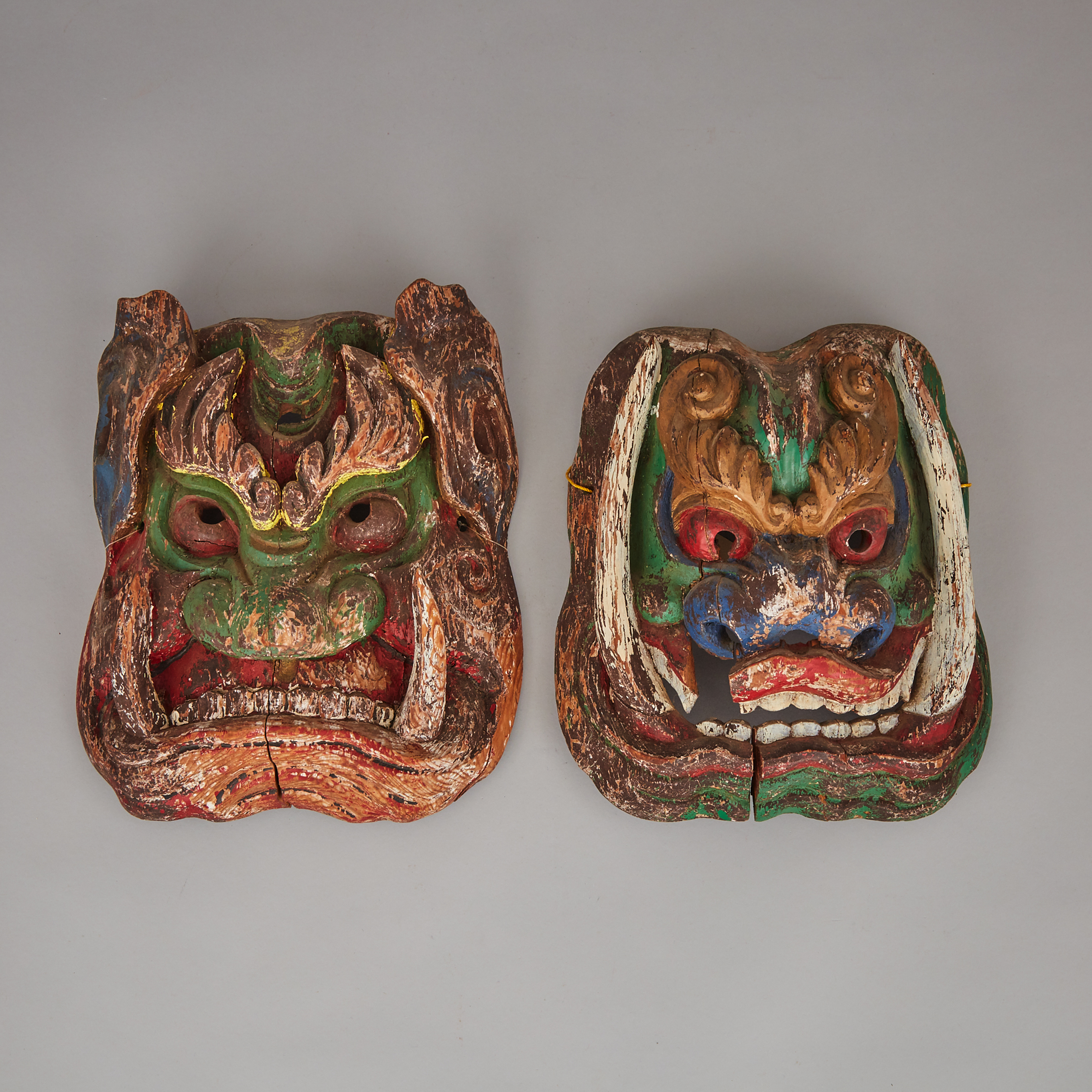 A Pair of Wood-Carved Masks of Wrathful Deities, Northern China