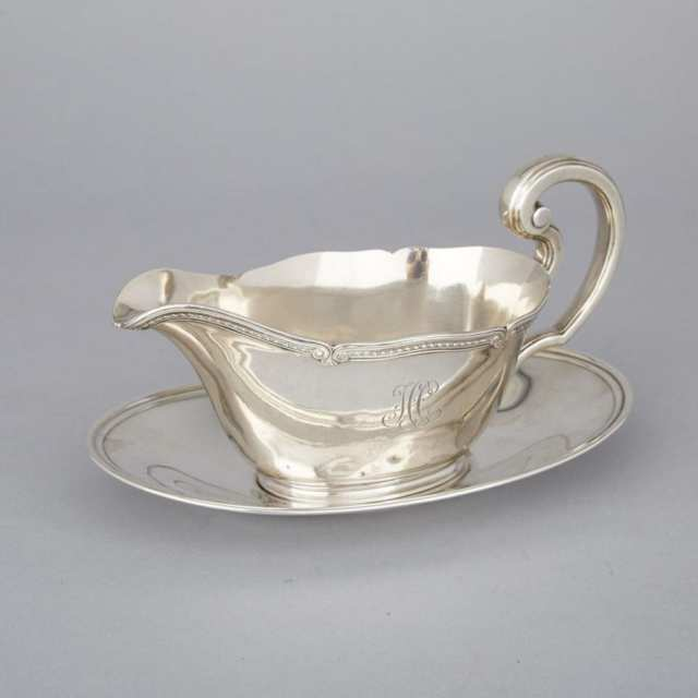 American Silver Sauce Boat, Tiffany & Co., New York, N.Y., and a Stand, International Silver Co., Meriden, Ct., 20th century