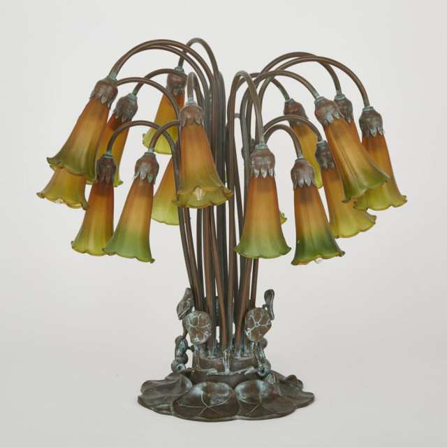 Tiffany Style Patinated Bronze and Favrille Glass Pond Lily 18 Light Table Lamp, 20 century