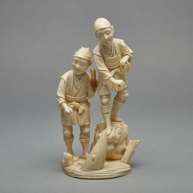 A Japanese Ivory Okimono of Two Fisherman, Early 20th Century