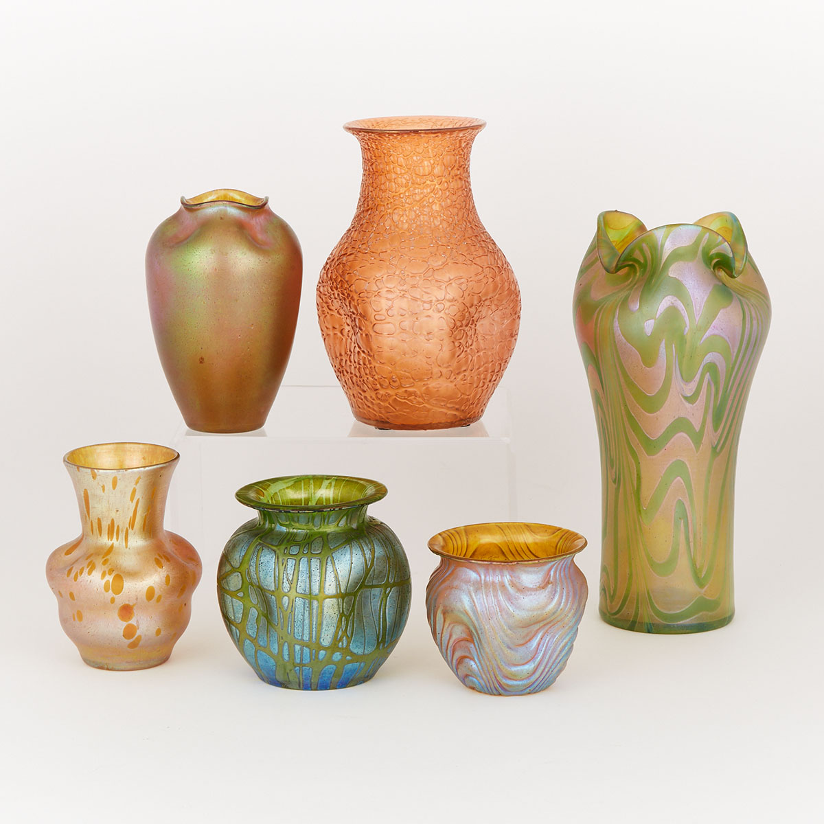 Six Bohemian Iridescent Coloured Glass Vases, early 20th century