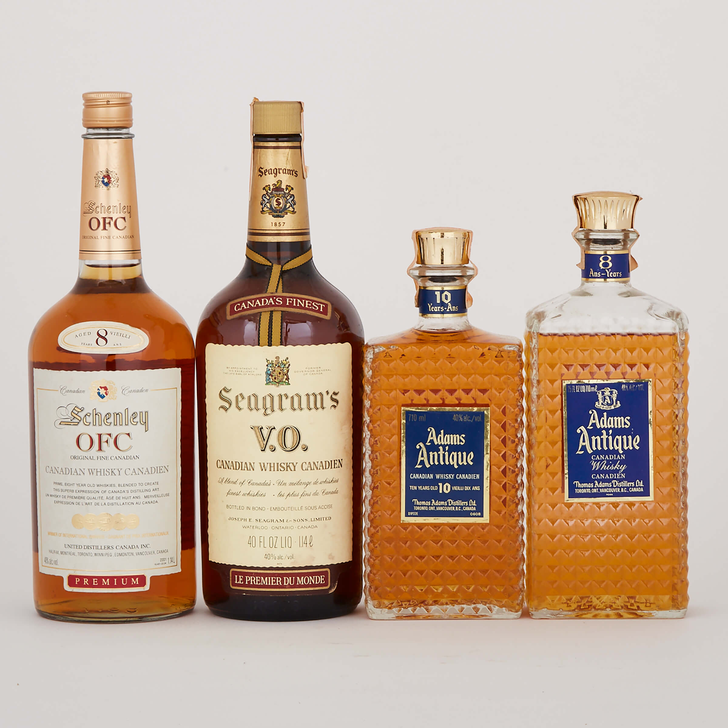 ADAMS ANTIQUE CANADIAN WHISKY 10 YEARS (ONE 710 ML) ADAMS ANTIQUE CANADIAN WHISKY 8 YEARS (ONE 710 ML) SCHENLEY CANADIAN WHISKY OFC 8 YEARS (ONE 1.14 L) SEAGRAM'S V.O BLENDED CANADIAN WHISKY 6 YEARS (ONE 40 OZ.)