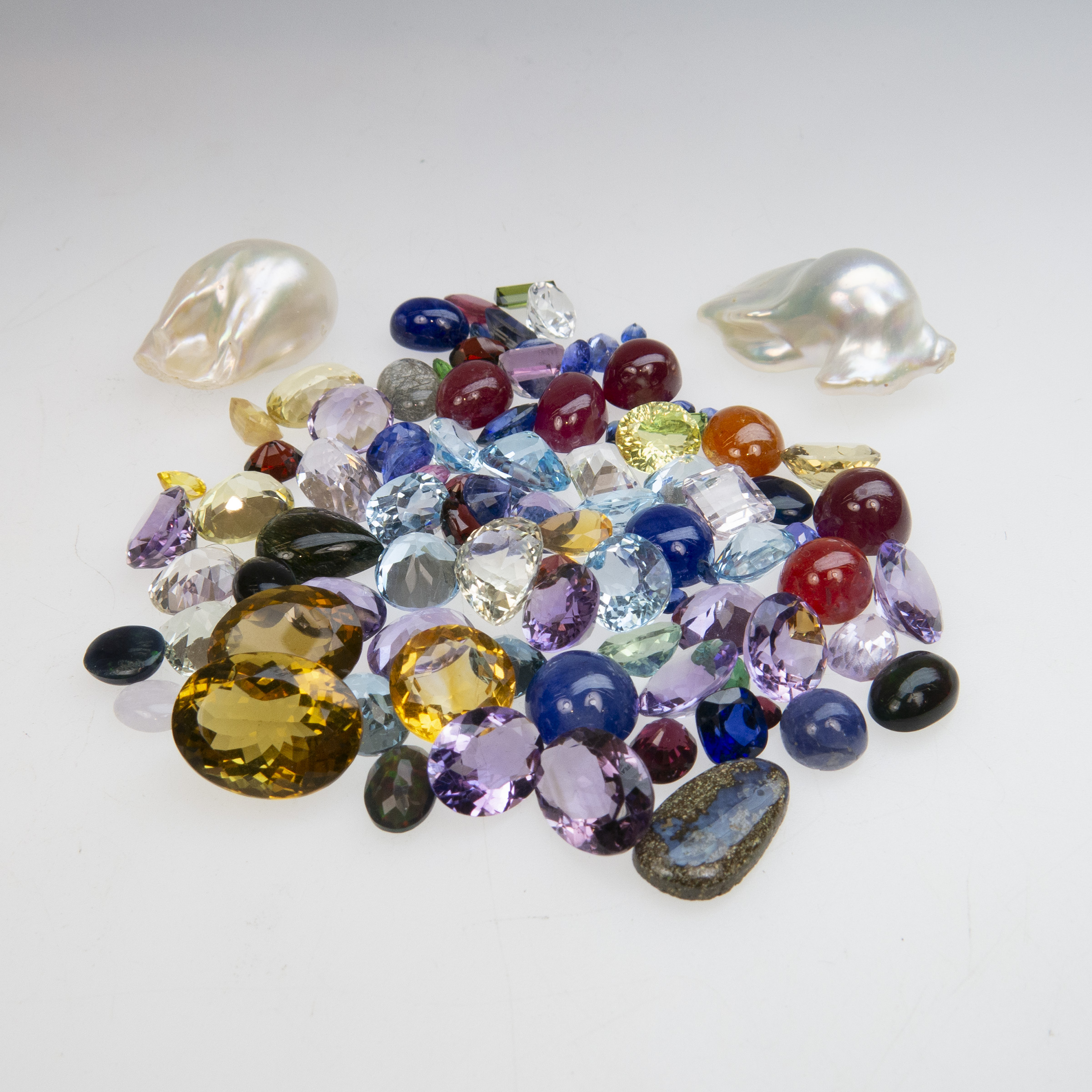 Two Large Baroque Pearls And A Quantity Of Various Unmounted Gemstones