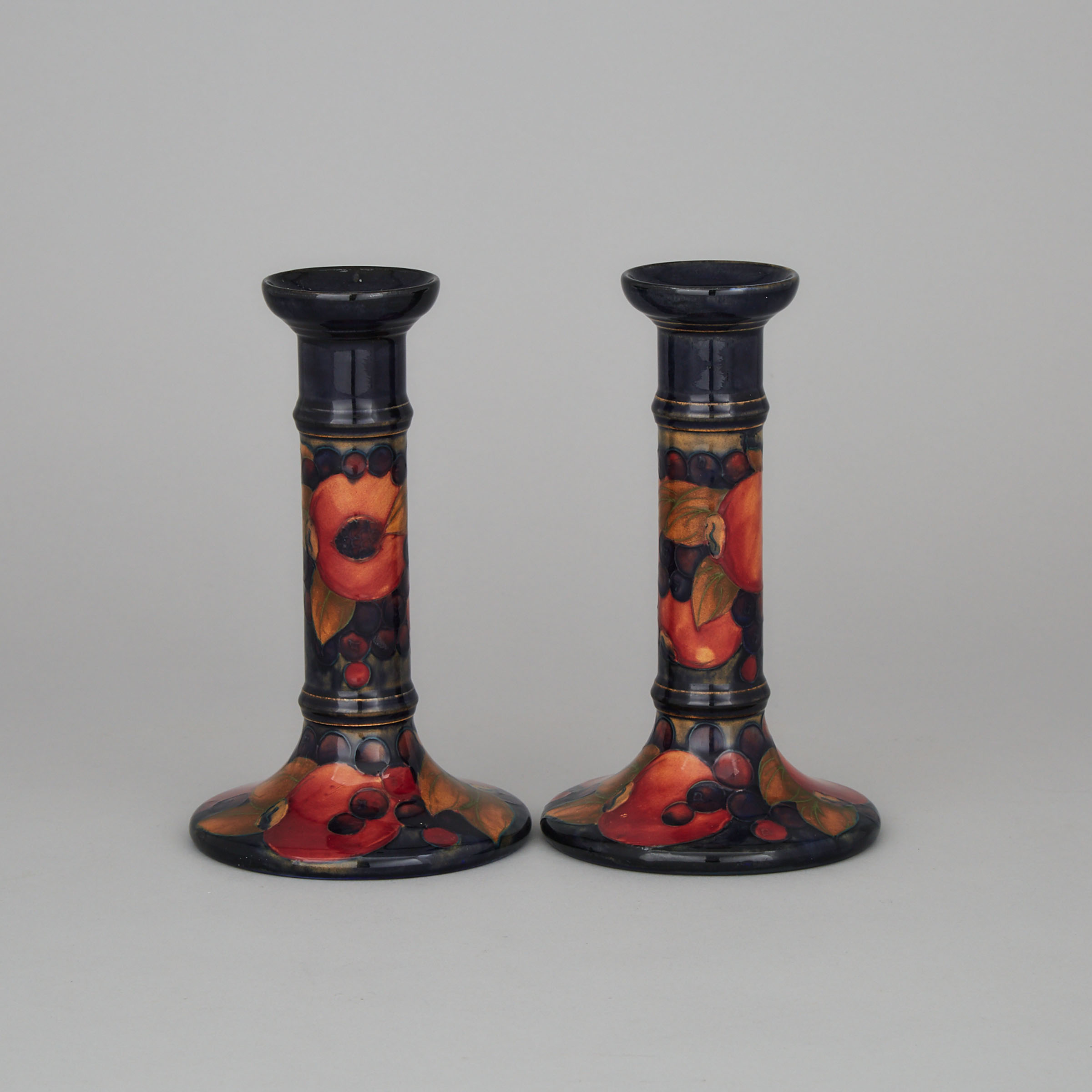Pair of Moorcroft Pomegranate Table Candlesticks, c.1925